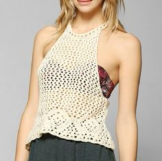 Staring at Stars Open-Crochet Crop Tank Top NWOT Knit tank top from Staring at Stars cut in an easy racerback fit. Delicate open-knit crochet with s high neckline and open strappy back. Urban Outfitters exclusive. Cotton, acrylic. Color is ivory. Urban Outfitters Tops Crop Tops