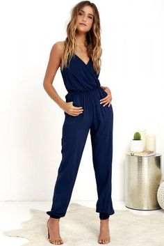 Even if you're too timid for skydiving, the Learning to Fly Navy Blue Jumpsuit will take you on an unexpected journey! This woven jumpsuit is as fun as it is cute, adding adjustable halter ties to a sexy wrap bodice, plus a strip of elastic at back for fi Navy Jumpsuit, Backless Jumpsuit, Jumpsuit Outfit, Sparkly Jumpsuit, Summer Jumpsuit, Dress Summer, Pants Outfit, Fashion Mode, Look Fashion