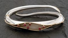 beautiful spiculum bracelet from Genevieve Flynn.  sterling silver and 14ky gold with bezel set pink spinels