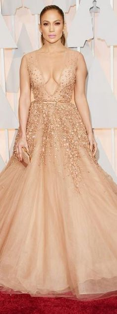 Jennifer Lopez's nude gown, jewelry, shoes, and purse that she wore to the 2015 Oscars in Hollywood red carpet fashion style  id