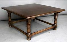 #10-100MOD1 CUSTOM TAVERN COFFEE TABLE. Available in solid Mahogany, Walnut, Oak or Alder, with a choice of different colors and ranges of distress. SHOWN HERE IN MEDIUM WALNUT WITH MEDIUM DISTRESS. - America As shown 42