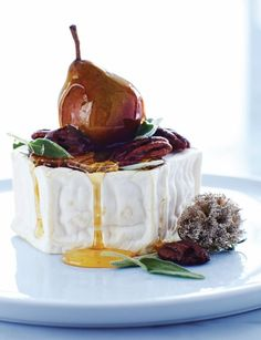 Brie with Pear, Nuts, & Honey. 1 small whole ripe wheel of brie, room temp. 1 small pear. 6 sage leaves. 6-8 candied walnuts. Honey. Place the brie on a platter and add pear, sage, and walnuts. Drizzle with honey and serve! Via Sweet Paul Magazine.