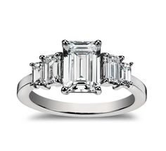 This diamond engagement ring showcases four graduated, emerald-cut diamonds set in enduring platinum.
