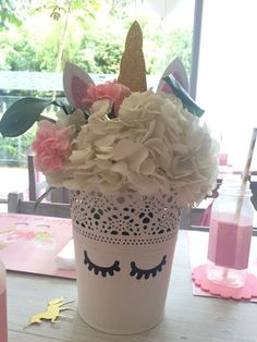 Loving the gorgeous centerpiece at this Unicorn Birthday Party! See more party ideas and share yours at CatchMyParty.com #unicorn #centerpiece