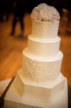 Wedding cake. I like the shape of the 2nd to bottom tier & I like the idea of each tier being a different shape but other than that this cake is kinda boring & really needs color
