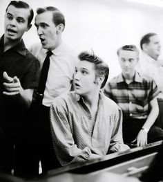 L-R Neal Mattews, Hugh Jarrett, Elvis at the piano, Gene Smith, and Steve Sholes.