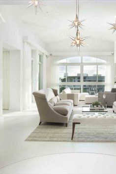 For this project in a luxury waterfront penthouse in Fort Lauderdale's Landings in Las Olas, DKOR Interiors was inspired by their clients' collection of pre-Columbian artefacts and their desire to remodel their home. The concept of old-world elements breaking through new-world components worked perfectly for them. The firm combined contemporary details—clean lines and crisp white walls—with traditional elements—wing back chairs and tufted upholstery—to create their clients' dream home.