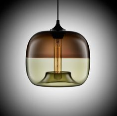 Two pieces of glass fused to produce the Encalmo-Stamen Modern pendant light. Lighting with personality(s).