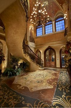 This is the house that I imagine myself wearing big fluffy ballgowns down the stairs and having fancy dinner parties and probably a ward robe in spare oom that leads to Narnia...or Hogwarts...and the ceiling can change like in the Great Hall and it can snow but not really get anything wet...
