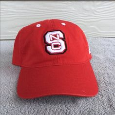 Brand New NC State Ball Cap This cap has never been worn and still has stickers on brim as well as lining. Has and adjustable back. Adidas Accessories Hats