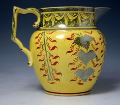 English pottery antique pitcher with canary yellow ground and silver ...