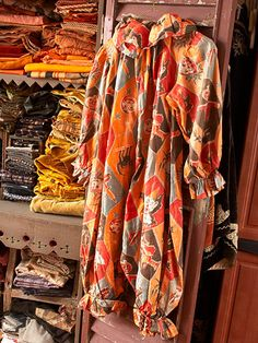 Fabric Foray - (Scott Smith)   For a seasonal display of Halloween color, fill an open cupboard with stacks of vintage Halloween fabrics or table linens and an old costume...