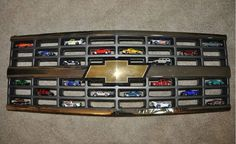 Displaying Hot Wheels in a Chevy grille. A cool place for all things miniture! Displaying Hot Wheels in a Chevy grille. A cool place for all things miniture!