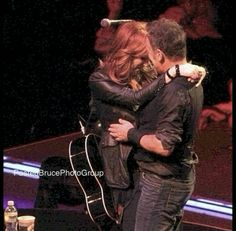 Bruce Springsteen and Patti Scialfa slow-dancing on stage during his show, 2012.