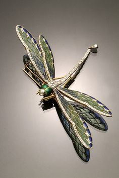 French Art Nouveau Hallmarked 18 K Yellow Gold, Platinum Topped, Plique-a-Jour Enamel, and Diamond Dragonfly Entremblant Brooch circa 1900.