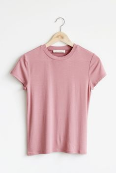 "Details Size Shipping • 95% Rayon 5% Spandex • Soft crewneck baby tee. • Hand Wash • Line dry • Imported • Measured from small • Length 22"" • Chest 15"" • Waist"