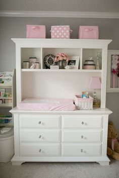 A bulky dresser can be used for a variety of things in the nursery. Sorting pajamas, creating a changing station and displaying nick-knacks and books on the shelves!