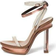 Emma Watson wearing Calvin Klein Spring 2011 Ankle-Strap Sandals.