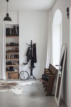 closet for shoes with floor to ceiling curtain