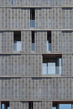 The sliding perforated aluminium panels cladding the building, allow each resident to modulate their own level of privacy.