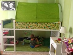 IKEA Kura Bed Hack; blue or green tent on top. toy/reading area below