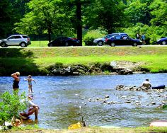 Such fun in the shallow Oconoluftee River in Cherokee, NC.