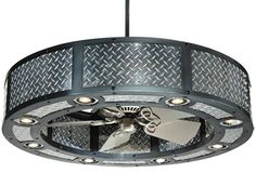 a car engine air filter made into a chandelier? Diamond plate fan surround with down-lights...