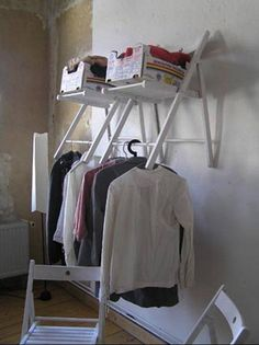 Old chairs hung to be used as clothing rods. - metal folding chairs spray painted??