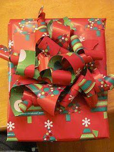 Wrapping paper bow made with left over paper scraps!