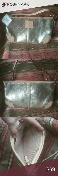 """NWT New Coach Large Wristlet, Wallet Gold Leather NWT New Coach Large Wristlet, Wallet Gold Leather silver hardware, inside has 7 credit card slots on one side and a slip pocket on the other side.  100% AUTHENTIC  Brand: Coach  Style: Large Wristlet  Name: Metallic  Large Wristlet E  Model: 50169E  Color: Gold  Width: 9.5""""  Depth: 1""""  Height: 5.75""""  Wristlet Strap Drop: 6"""" Coach Bags Clutches & Wristlets"""