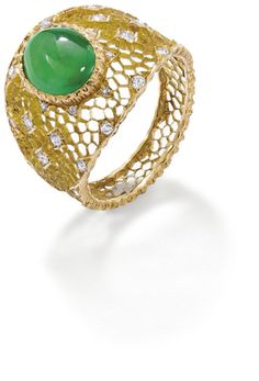 A jade and diamond ring  The oval cabochon jade set to the centre of the tapered openwork honeycomb band, accented with circular-cut diamonds, ring size M, signed 'Gianmaria Buccellati'.