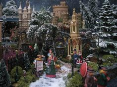 Beautiful close up of a Dickens' Village scene. Love the illusion of a snow fall in the background! Lemax Christmas Village, Lemax Village, Halloween Village, Christmas Villages, Christmas World, A Christmas Story, Christmas Carol, Christmas Holidays, Christmas Decorations