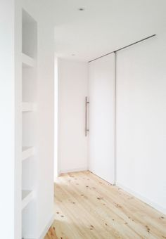 White room with wooden floor | A House by 08023 Architects in Barcelona | #Houses