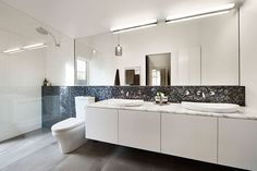 East Malvern Residence is a classic brick Federation house updated for modern family living by LSA Architects, located in Malvern, Melbourne, Australia. Wooden Bathroom Vanity, Bathroom Vanity Makeover, White Bathroom, Dark Bathrooms, Beautiful Bathrooms, Modern Bathroom Design, Bathroom Interior Design, Modern Interior, Kitchen Design