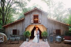 Taking place at the Georgia barn wedding venue, The Buie Barn, this wedding features some beautiful scenery and a hands down lovely reception. Sarah and Stephan hosted their wedding ceremony in a church and followed that up with a beautiful barn wedding reception. The stunning wedding details rustic wedding decorations make for a classy wedding …