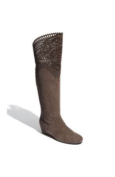 Obsessed with the perforated, lattice detail..this brand usually fits wide calves like mine too