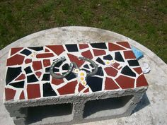 A cinder block for the garden in the process of being decorated with tile.