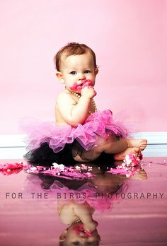cute combo of the pink/black tutu with pearls...