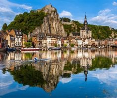 Between the river and the rock face over a steep-sided valley where the river cuts deeply into a plateau lies one of the small yet most beautiful towns of Europe called Dinant. | 10 Secret European Little Towns You Must Visit