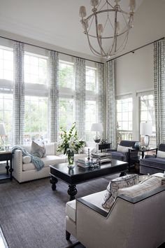 a fresh take on the overdone, dated look of the two-story family room; still a waste of space, but in a warm climate, it has its perks; Heather Scott Home & Design | Interior Design and Retail Boutique | Austin, Texas