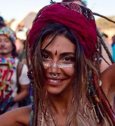 The goddess Nahal wearing glotatts on her face ( metallic gold tattoos ) festival fashion, dreadlocks, summer <3
