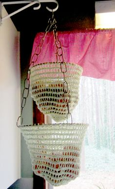 Free Knitting Pattern for Cestino Hanging Baskets - This hanging basket was originally designed to hold produce, but can be used for other items and holds about 5 pounds per basket. Options for two different sizes and two different depths included. Designed by Jenn Skinner