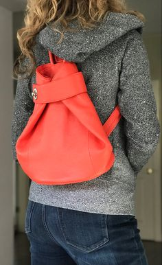 This is bag is fabulous - especially in this orange coral! It's stylish and functional. Zip closure with inside zip and slip wall pockets. Small zip outside wall pocket - perfect for mask and keys. Checkout all the ways to carry on our website. Available in several colors. #womensbackpack #womensleatherpurse #womensleatherpursesandwallets #orangehandbags #italianhandbags #leathertote #fashionbackpack #leatherbag #pursesandbags #everydaycarry #leathertotebag Orange Handbag, Orange Backpacks, Italian Leather Handbags, Leather Backpack Purse, How To Make Handbags, Stitching Leather, Fashion Backpack, Coral, Wall Pockets