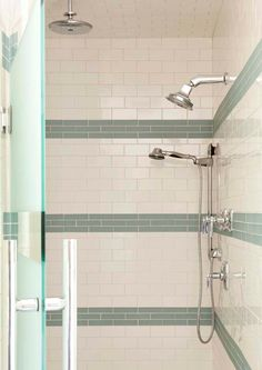 "tile borders in shower.. maybe do a ""picture frame"" on the back wall of the shower, and stripes on the sides?"