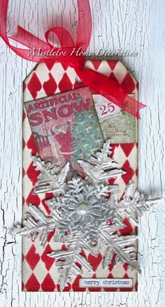 Mistletoe Home Decoration: Christmas tag with harlequin pattern and snowflake by Tim Holtz