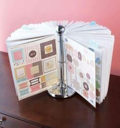 paper towel holder, binder rings, plastic sleeves.. a great way to show off your children's artwork :-)