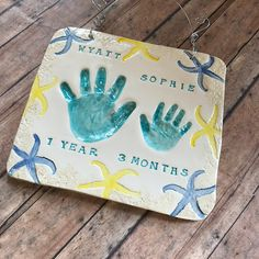 Ocean inspired water color inspired sibling hand print impressions in clay. Baby Hand And Foot Prints, Baby Prints, Spring Crafts For Kids, Art For Kids, Clay Handprint, Baby Footprint Art, Baby Footprints, Baby Hands, Baby Art