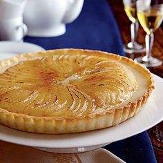 """Since most people make an effort to save room for dessert, I came up with something special. This tart combines elements of every good dessert--flaky crust, crunchy caramelized sugar, creamy custard, and soft roasted fruit. You can make all the components ahead of time, but brûlée the pears just before serving."" --SaBrina Bone, Test Kitchen Professional"