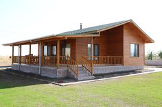 This wooden home looks like a traditional rustic house but it's actually a modern prefab house. It's rustic charm reminds us of a cozy farmhouse. This prefabricated wooden home is designed by Kuloğlu Orman Ürünleri Prefabricated Houses, Prefab Homes, Cabin Homes, Cottage Homes, House In The Woods, My House, Bamboo House, Home Buying Process, Charming House