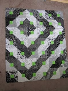 Love black and white quilts and with the little bit of green - fab!!